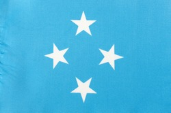 fabric national flag of the Federated States of Micronesia close-up