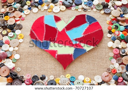fabric scraps heart on texture background. Valentine's Day. Buttons frame