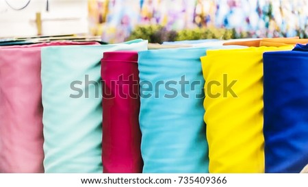 Fabric Store, Traditional fabric store with stacks of colorful textiles, fabric rolls at market stall - textile industry background with blurred.