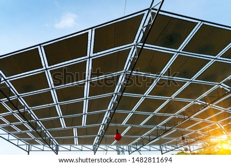 Fabric tensile roof ,Canvas or tent roof top construction with tension membrane and steel structure.fabric tensile roofs with skylight,blue sky background. #1482811694