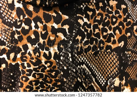 fabric texture background in snake pattern with leopard pattern     #1247357782