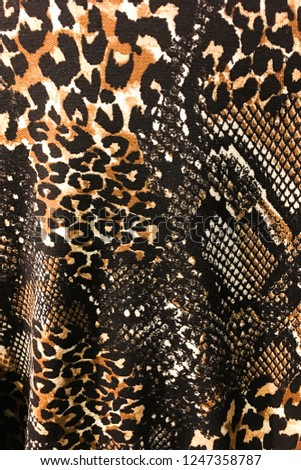 fabric texture background in snake pattern with leopard pattern     #1247358787