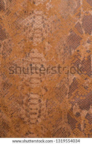 fabric texture background in snake pattern with leopard pattern