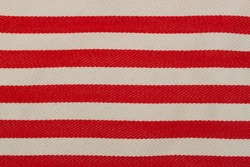 Fabric texture background. Red - white striped color. With copy space for text or image.