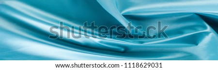 Fabric texture blue. Lining satin. Useful for photons. Photo studio. Abstract wave textile texture or background in blue color. Texture blue satin, silk background #1118629031