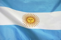 Fabric texture flag of Argentina. Flag of Argentina waving in the wind. Argentina flag is depicted on a sports cloth fabric with many folds. Sport team banner.