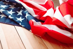 Fabric texture flag of USA. Flag of United States of America on wooden background.