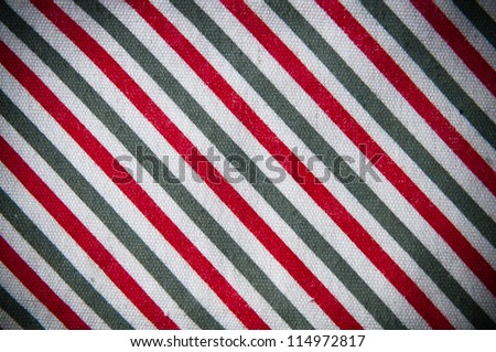 Fabric texture in gray and red stripes close up
