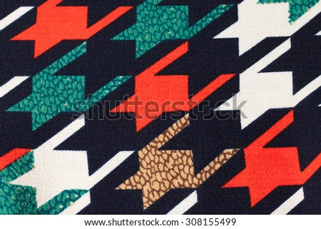 Fabric texture retro print navy blue, green, red, white. Texture background.