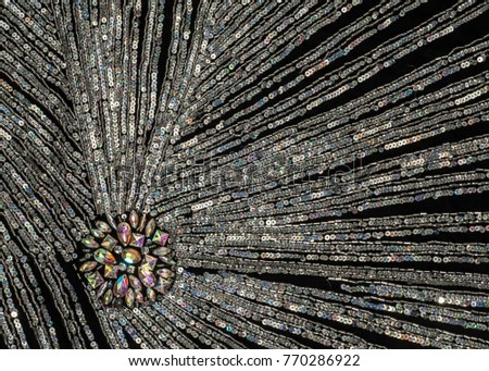 Fabric texture sequined.  jeweled, spangly, beady