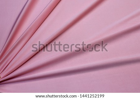 Fabric viscose. Knitwear pink colour. Texture, background, pattern. #1441252199