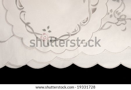 fabric with embroidery and scalloped edges on black