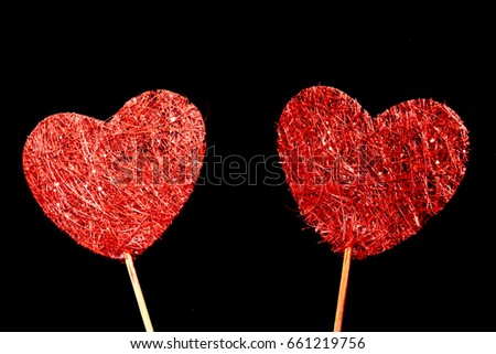 Fabric Wooden Heart Shapes on Sticks on Black background #661219756