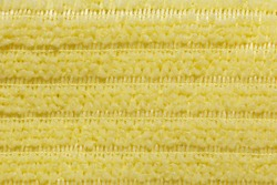 Fabric yellow striped background. Soft fiber texture of interlaced polyester. fine grain fabric.