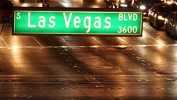 Fabulos Las Vegas, traffic sign glowing on The Strip in sin city of USA. Iconic signboard on the road to Fremont street in Nevada. Illuminated symbol of casino money playing and bets in gaming area.