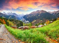 Fabulous autumn view of picturesque alpine Wengen village and Lauterbrunnen Valley with Jungfrau Mountain and  on background. Location: Wengen village, Berner Oberland, Switzerland, Europe.