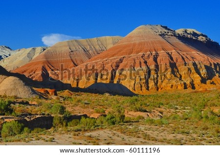 Fabulous colorful mountains in evening sunlight in kazakh steppe