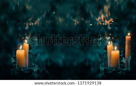 fabulous Night forest and magic candles. mysterious fairy scene. witchcraft ritual. fall season natural Background. Samhain, Halloween holiday concept. copy space Stock fotó ©