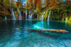 Fabulous place with colorful deciduous trees and stunning waterfalls in the forest at autumn. Great hiking destination with picturesque lakes and watrefalls, Plitvice National Park, Croatia, Europe