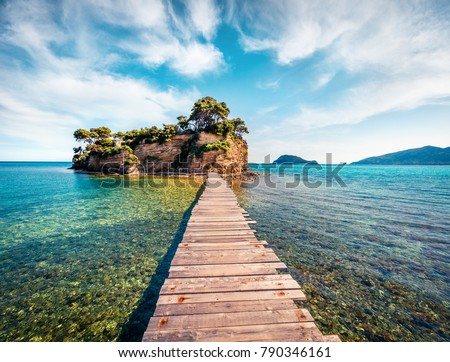 Fabulous spring view of Cameo Island. Sunny morning scene of Port Sostis, Zakinthos island, Greece, Europe. Beauty of nature concept background.