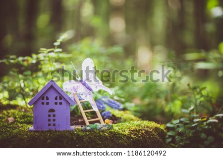fabulous, toy house, the colors of lavender, against the backdrop of a fairy forest. Concept cozy home, cozy world. #1186120492