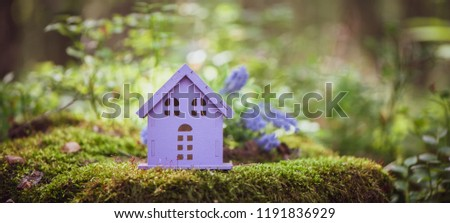 fabulous, toy house, the colors of lavender, against the backdrop of a fairy forest. Concept cozy home, cozy world. #1191836929