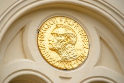 Facade detail of the Nobel Peace Center in Oslo, Norway decorated with an enlarged copy of the Nobel Peace Prize medal.