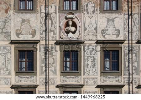 Facade detail with sgraffitto wall decor at Palazzo della Carovana in Pisa, Italy