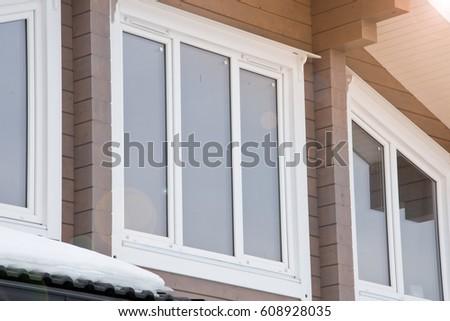 Facade modern wooden house with Windows. #608928035
