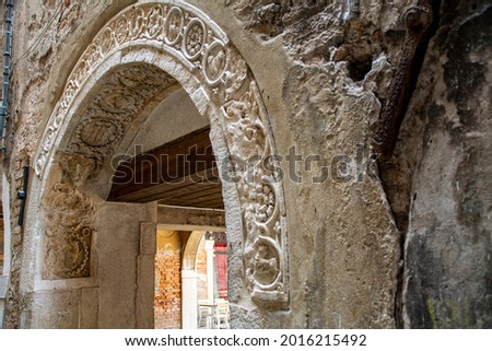 Facade of a historic building in Venice, Italy with a frieze of a decorative bas-relief Stockfoto ©