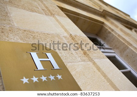 Facade of a luxury 5 stars hotel - stock photo