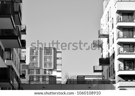 Facade of a modern apartment building. Black and white. #1060108910