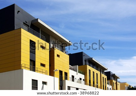 Facade of a modern apartment condominium in a sunny day