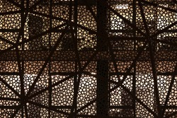 Facade of a modern building. Round geometric patterns. Night shooting