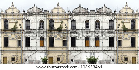 Facade of a row of old weathered medieval tenement shophouse.