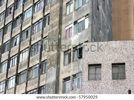 Facade of a rundown building in a poor neighborhood in the center of Sao Paulo, Brazil.