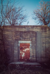 Facade of an abandoned ammunitions store, built in 1940, at the former Joliet Army Ammunition Plant. Now part of the Midewin National Tallgrass Prairie Nature Reserve, Wilimington IL, USA