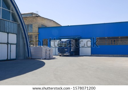facade of an industrial building and warehouse with freight car #1578071200