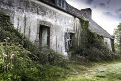 Facade of an old abandoned provincial fisherman house near the atlatic ocean, St Brieuc, Brittany, France.