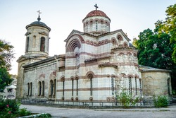 Facade of ancient Church of Saint John The Baptist in Kerch, Crimea. It was founded in VIII century. Built in classic Byzantine style in stone with main building & bell tower