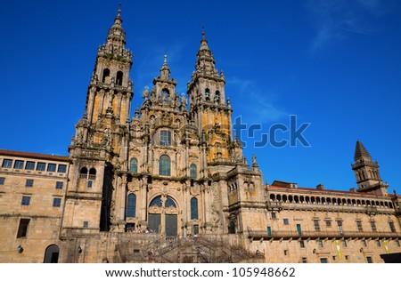 Facade of Cathedral of Santiago de Compostela with blue sky