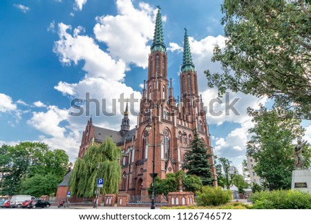 Facade of Cathedral of St. Michael the Archangel and St. Florian the Martyr in Warsaw, Poland #1126746572