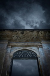 Facade of old ancient window architecture building, Halloween mystery background