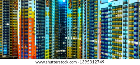 facade of residential apartments in modern metropolis. Night, background texture #1395312749