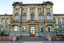 Facade of Romanov women's gymnasium in Kerch, Crimea. School was built in honor of Russian Tsar's family. Now it's one of most attractive old buildings in city