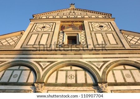 Facade of San Miniato al Monte in Florence, warm sunset light shot.