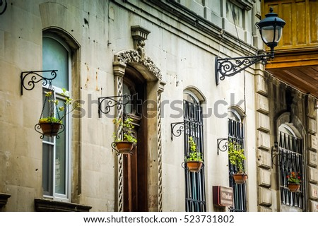 Facade of the building. Elegant architecture. Elegant building architecture. Hotel facade. Building background. Building detail. Building facade. Building facade in Old City #523731802