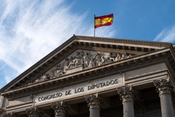 Facade of the Congress of Deputies in Madrid, Spain, with Spanish flag waiving