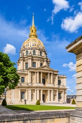Facade of the Dome des Invalides in Paris, France, with its golden cupola, a former church which houses the tomb of Napoleon Bonaparte.
