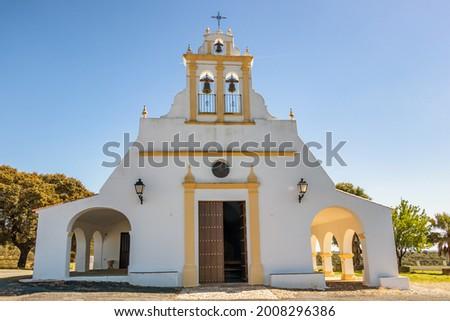 Facade of the hermitage of Nuestra Señora de Piedras Albas, located in the Prado de Osma area, El Almendro. The church dates from the 15th century and it has a single nave covered with a barrel vault  Foto stock ©
